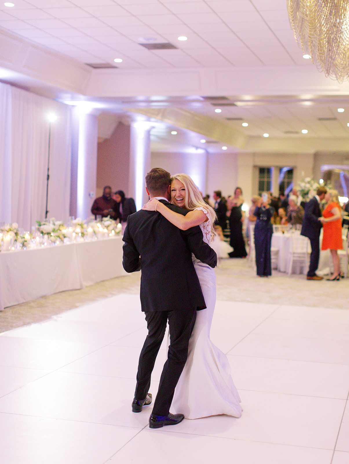 Bride smiling dancing with her husband