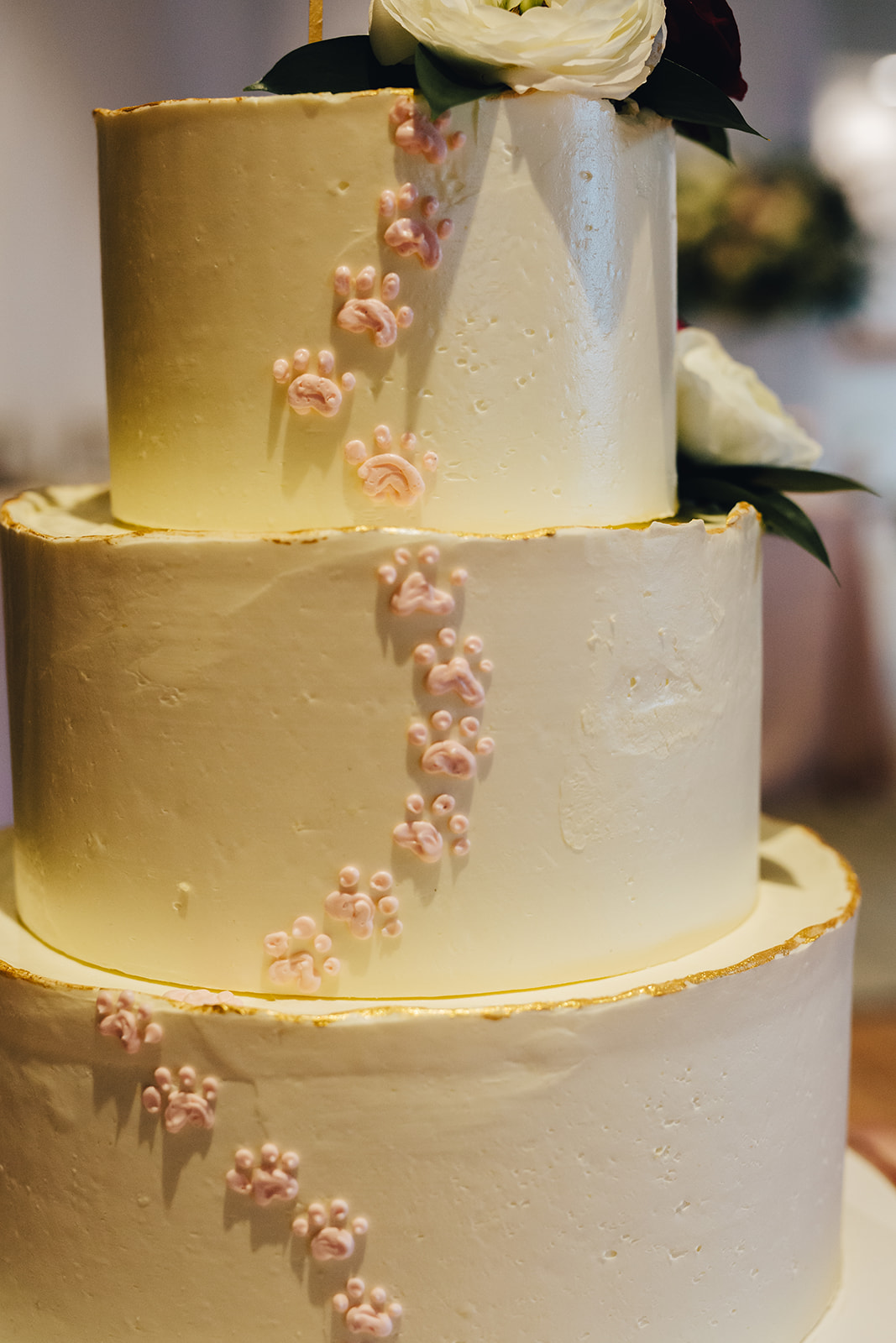 West Bay Beach wedding cake with paw prints on the side