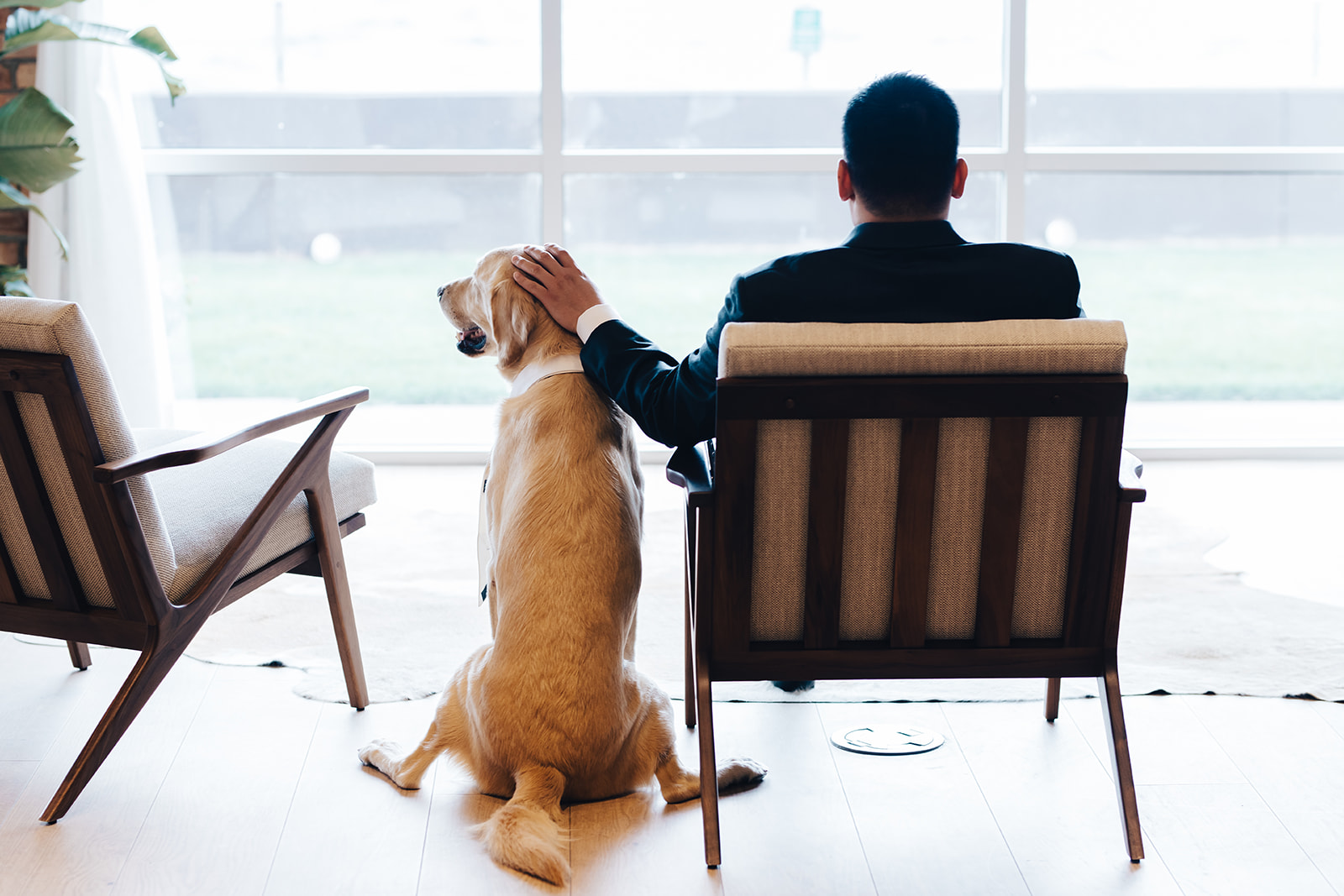 Groom sitting with his dog