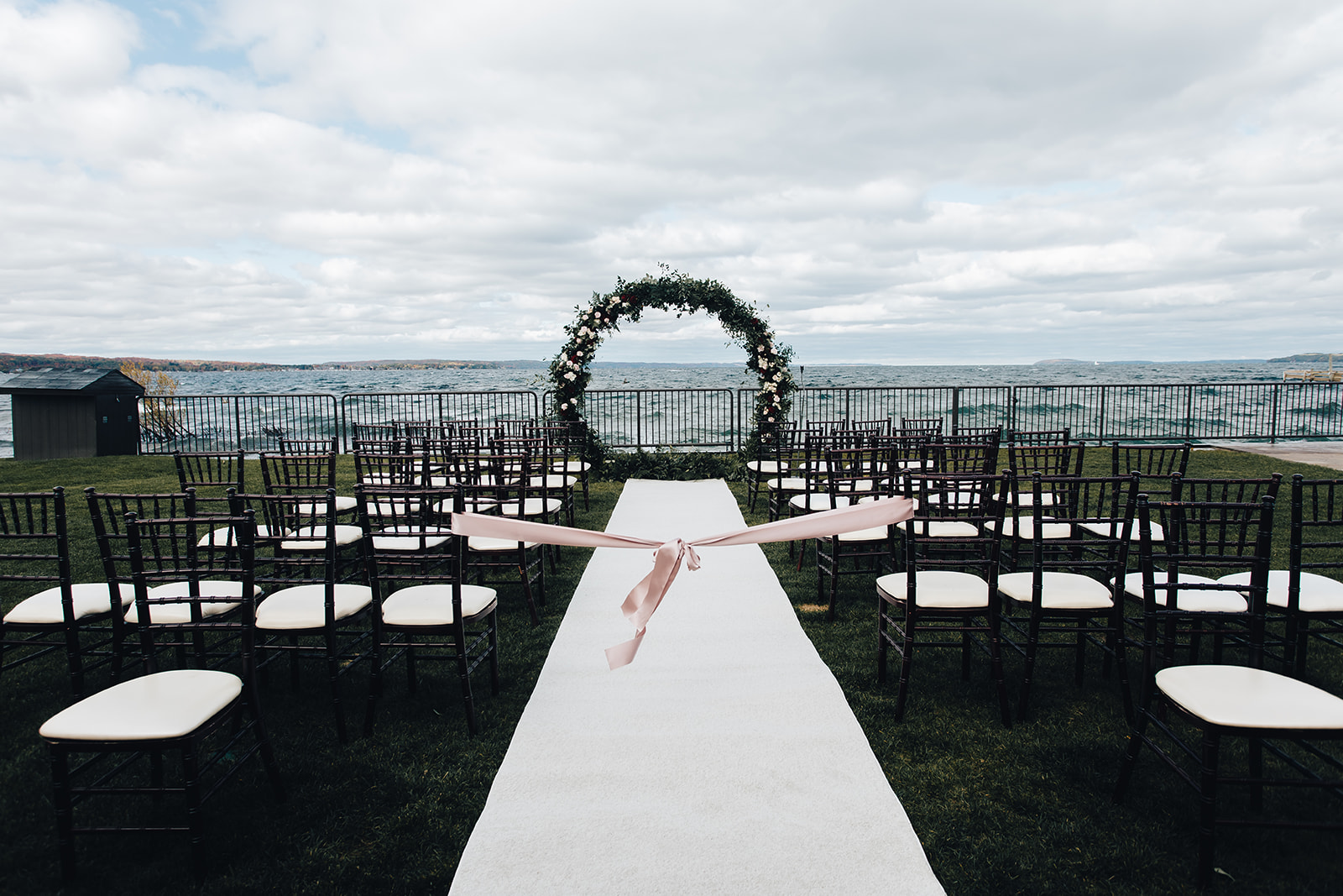West Bay Beach wedding ceremony space next to lake