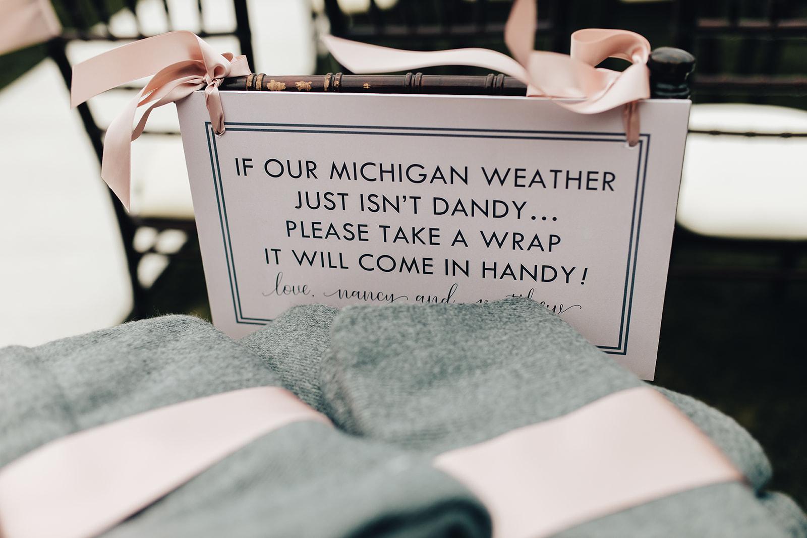 Blanket wrap sign for West Bay Beach wedding