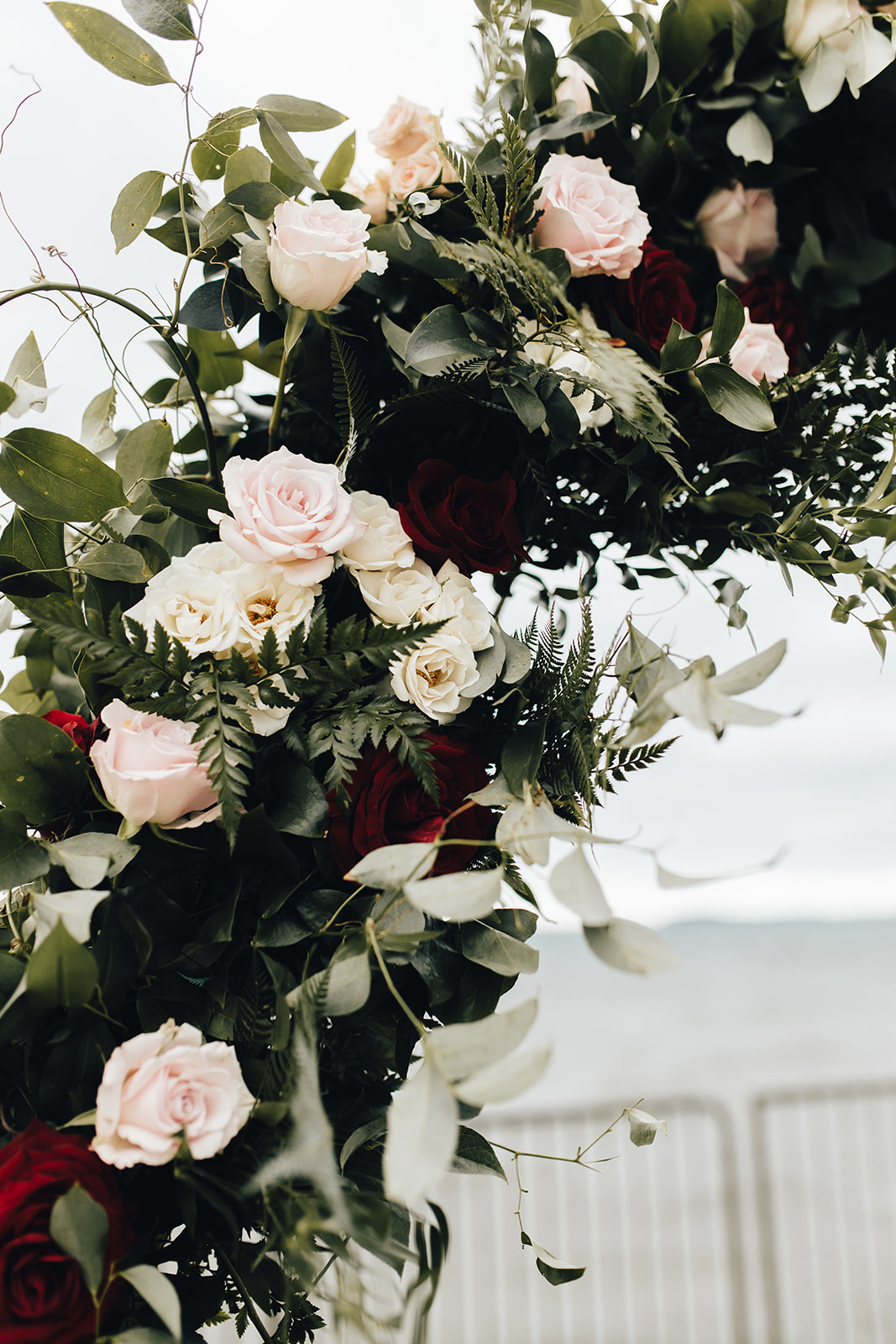 Floral decor on archway of West Bay Beach wedding