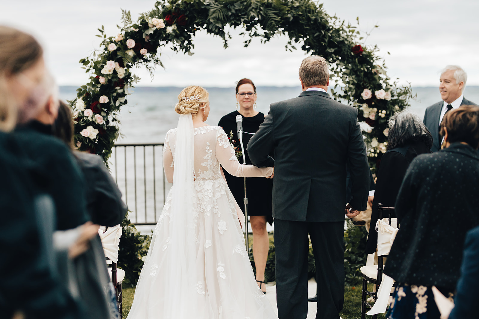 Father of bride giving her away to groom