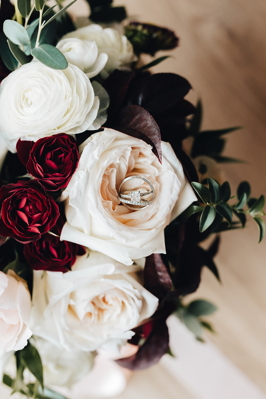 West Bay Wedding rings on floral bouquet