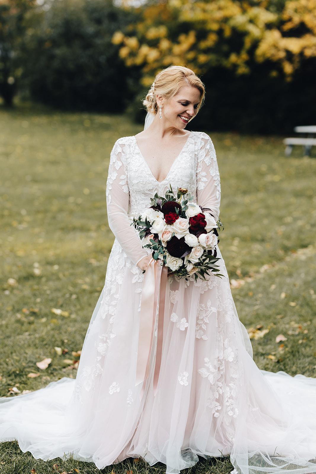West Bay Beach bride holding her wedding bouquet