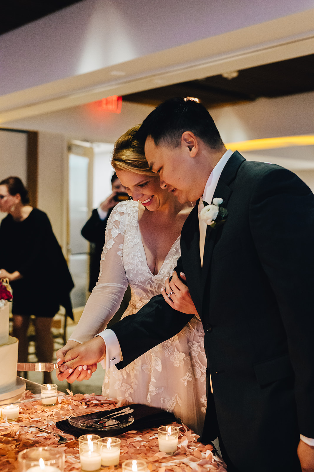 Bride and groom cutting their cake smiling