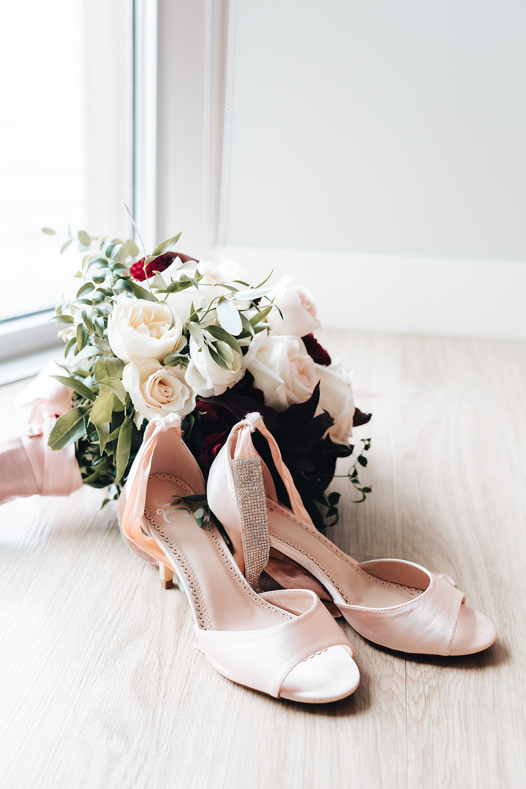 Bride's shoes and bouquet for West Bay Beach wedding