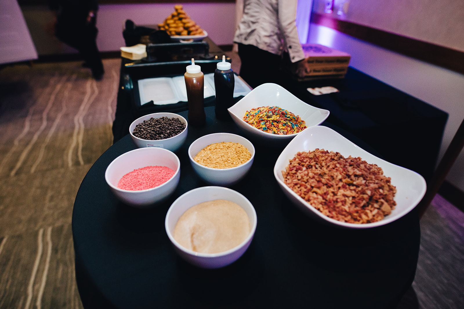 Donut toppings display for West Bay Beach wedding