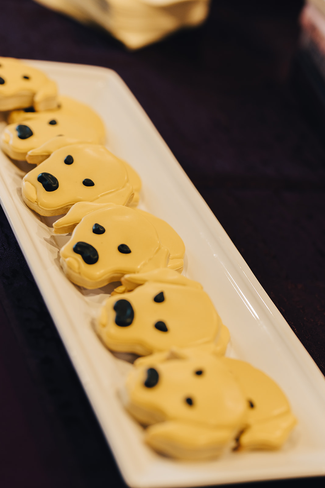 Dog face shaped cookies for West Bay Beach wedding