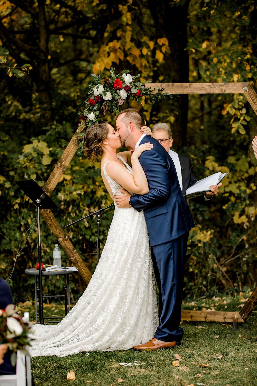 Bride and groom kissing at Jackson, MI wedding