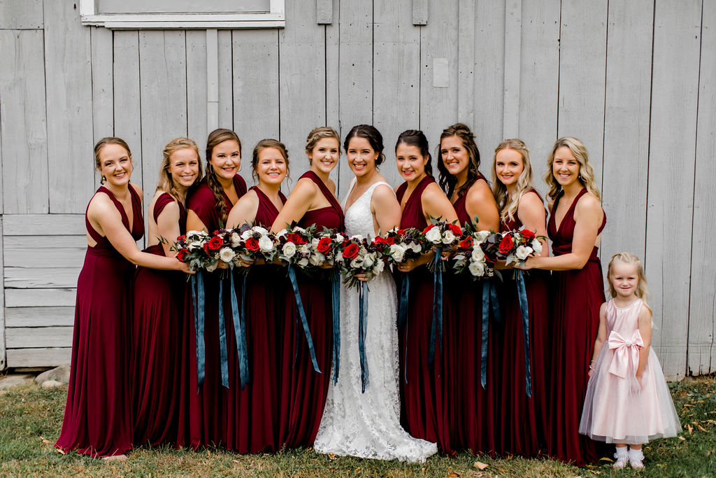 Bridal party smiling holding bouquets