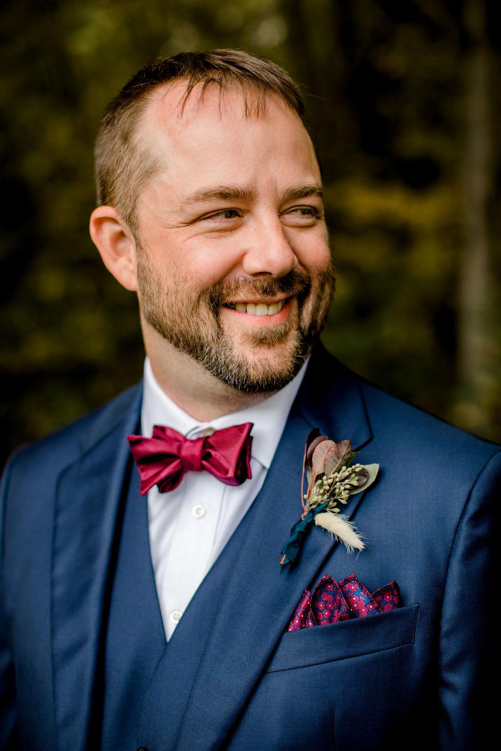 Groom smiling before Jackson, MI wedding