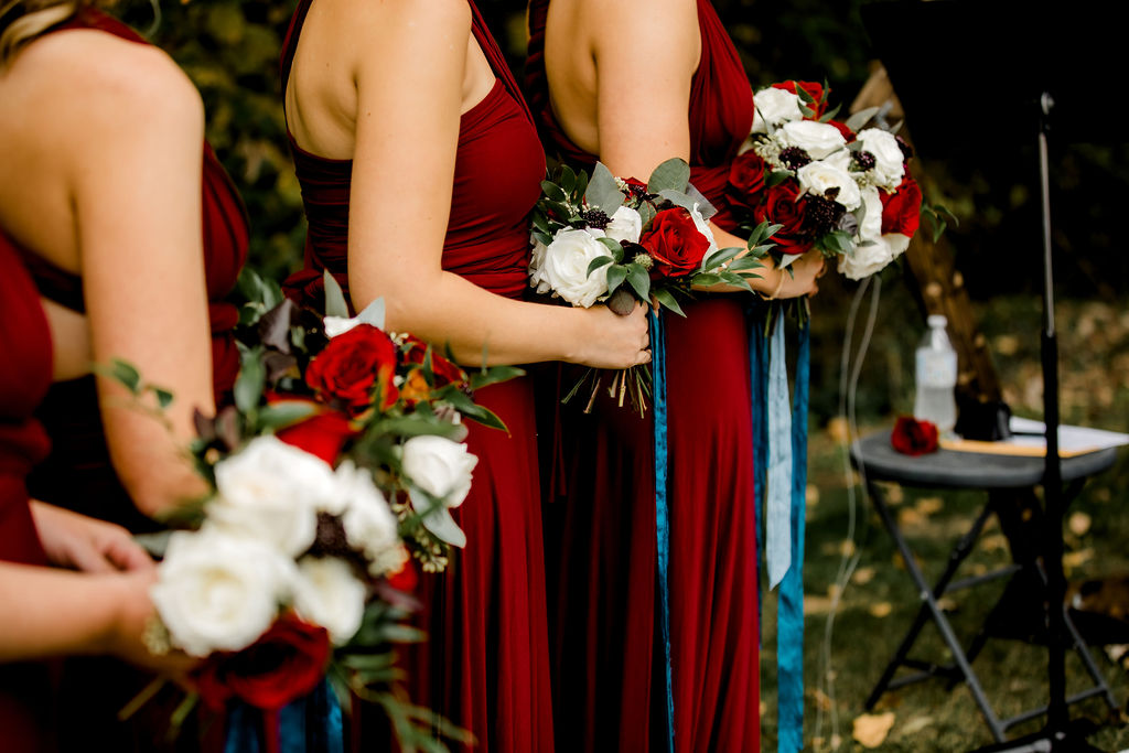 Bridesmaids holding bouquets at Jackson, MI wedding