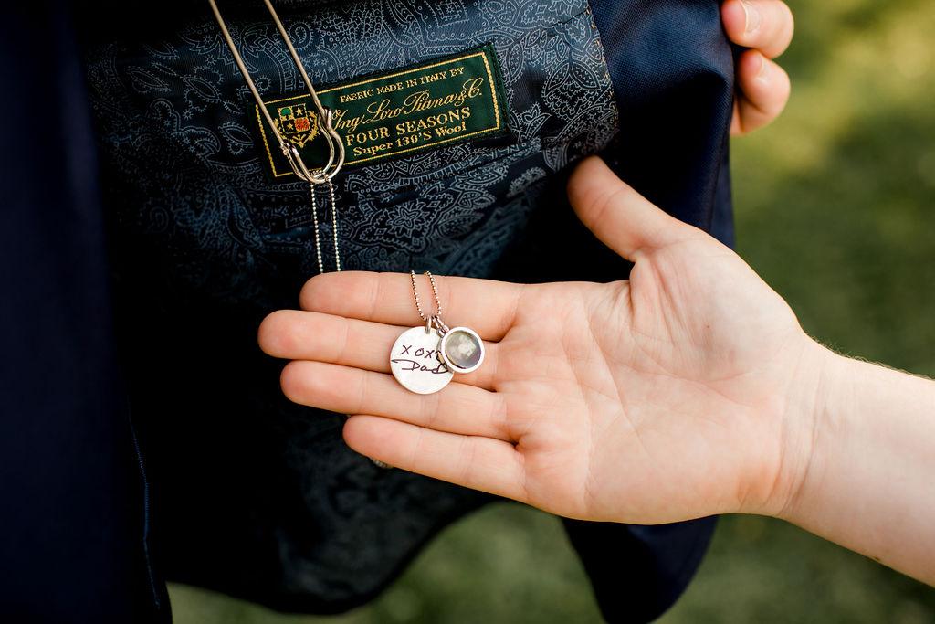 Charm on grooms jacket