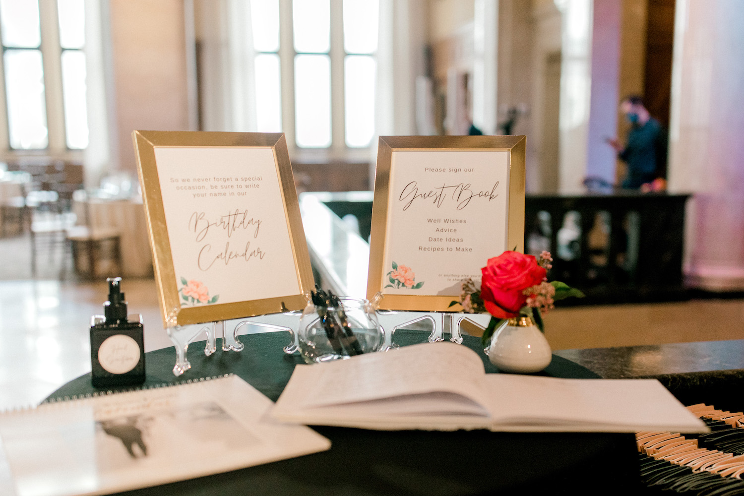 Guest book signs and book for City Flats Hotel wedding