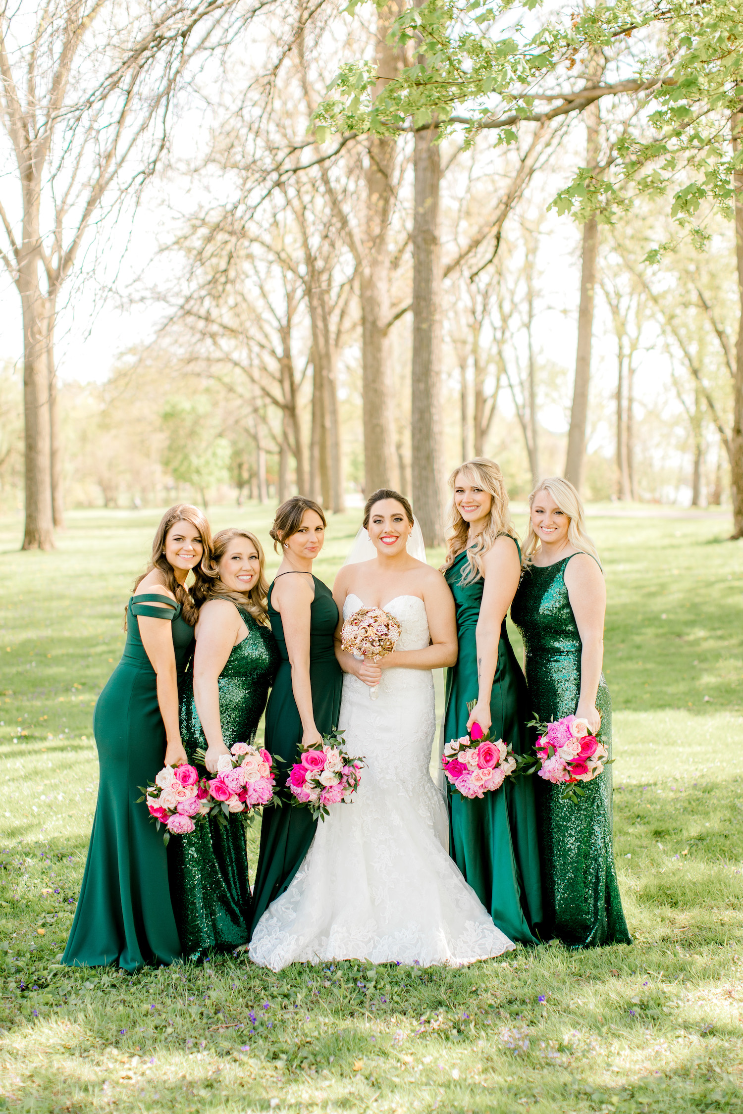 Bride standing with her bridesmaids outside