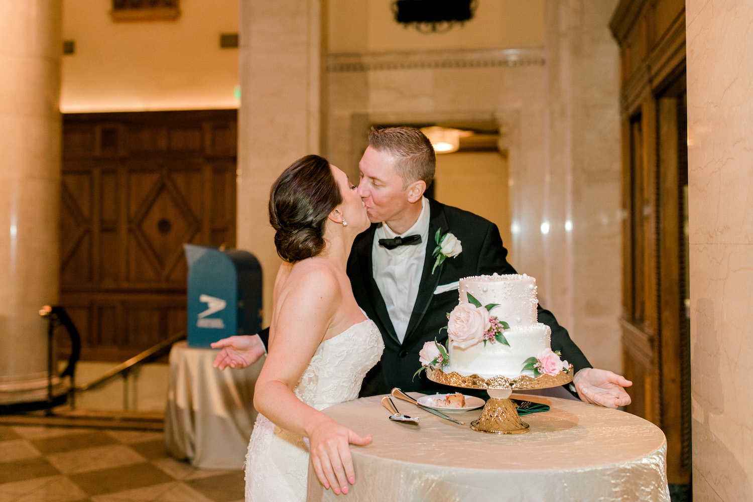 Bride and groom kissing after cake cutting