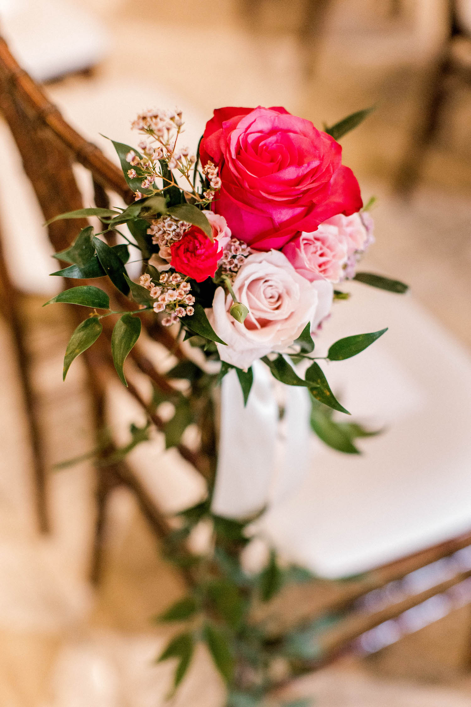 Pretty flowers on chair at City Flats Hotel wedding