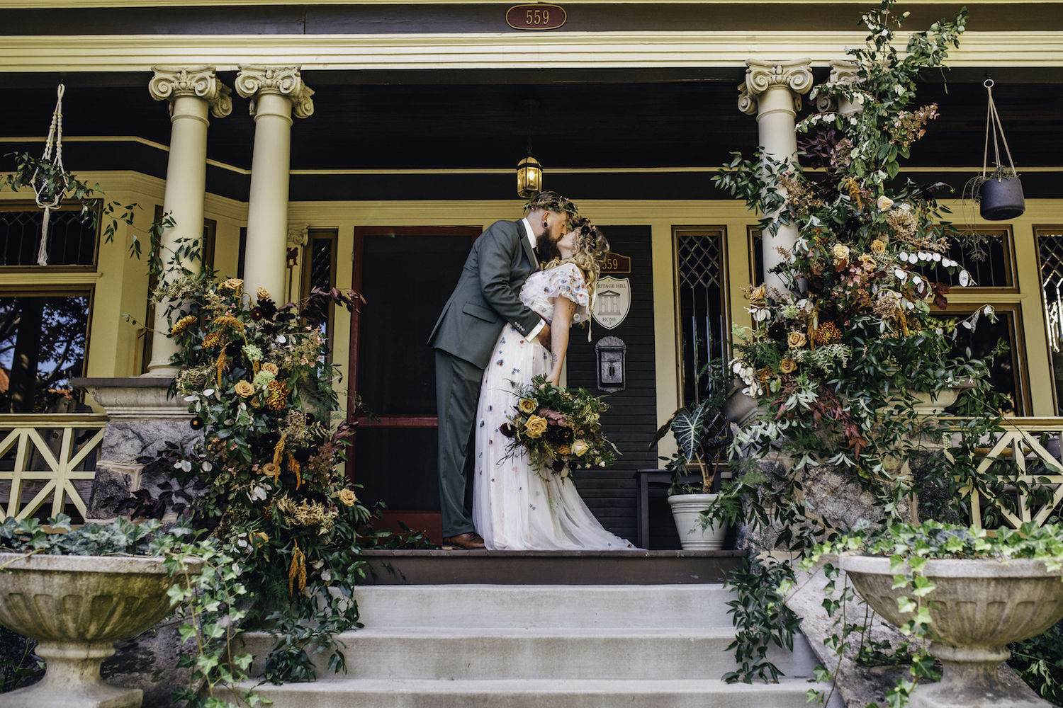 Groom kissing his bride on front porch