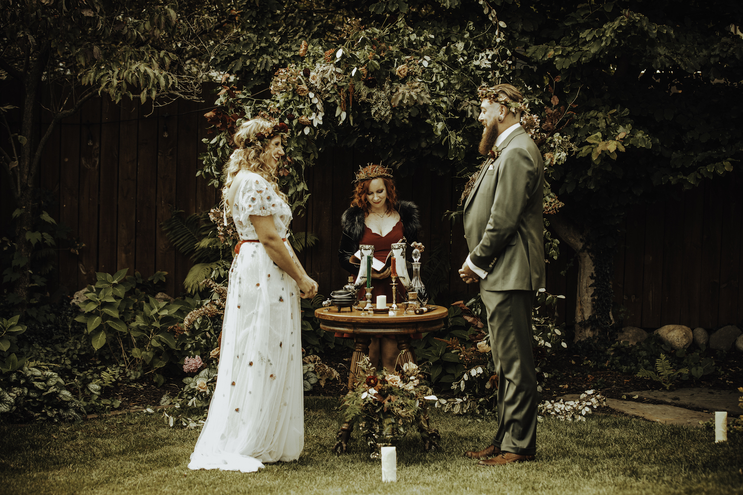 Bride and groom standing at alter of Grand Rapids Backyard wedding