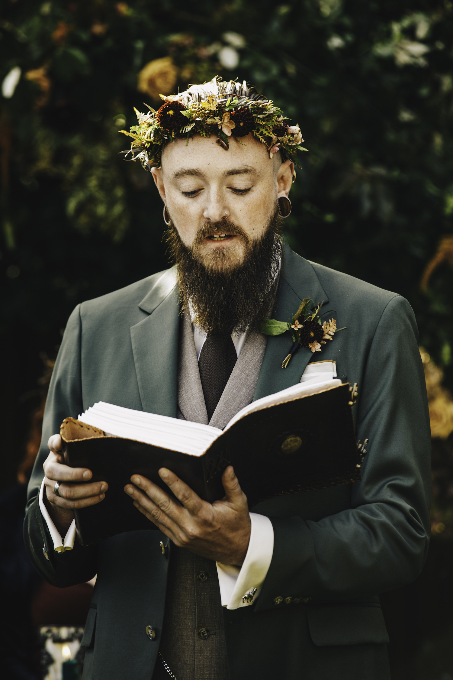 Groom reading from book