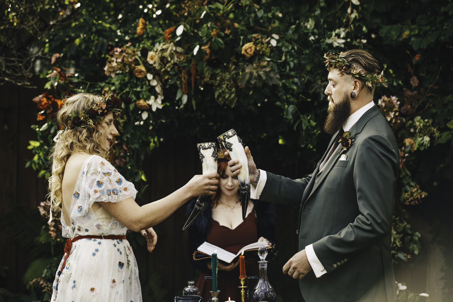 Bride and groom toasting to each other at alter