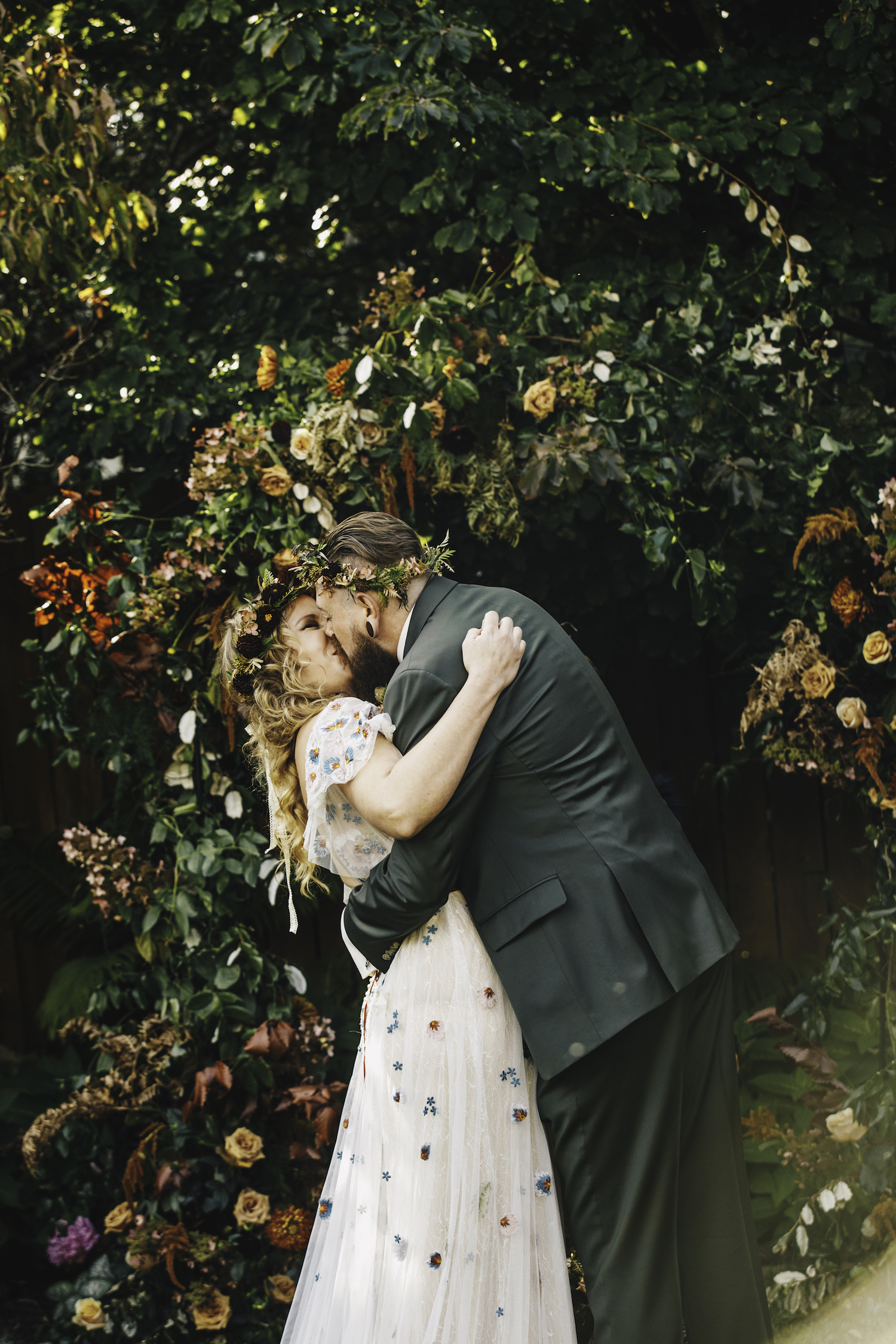 Bride and groom kiss after ceremony of Grand Rapids Backyard wedding