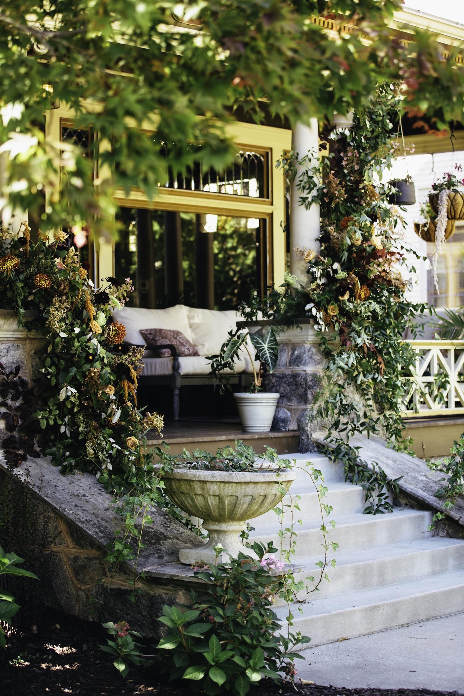Floral decor on porch of Grand Rapids Backyard wedding